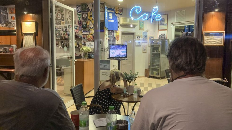 Fans watch Game 6 of the NBA Finals at a coffee shop, in the Sepolia district of Athens,...