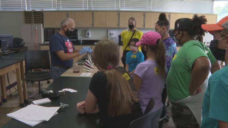 Girls get hands on experience learning about careers in fire, law enforcement and forensic...