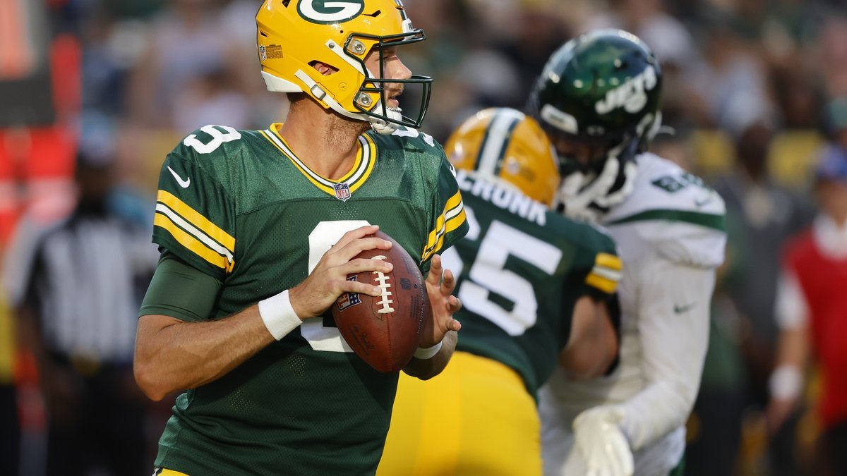 Green Bay Packers quarterback Jacob Dolegala looks to pass during the second half of an NFL...