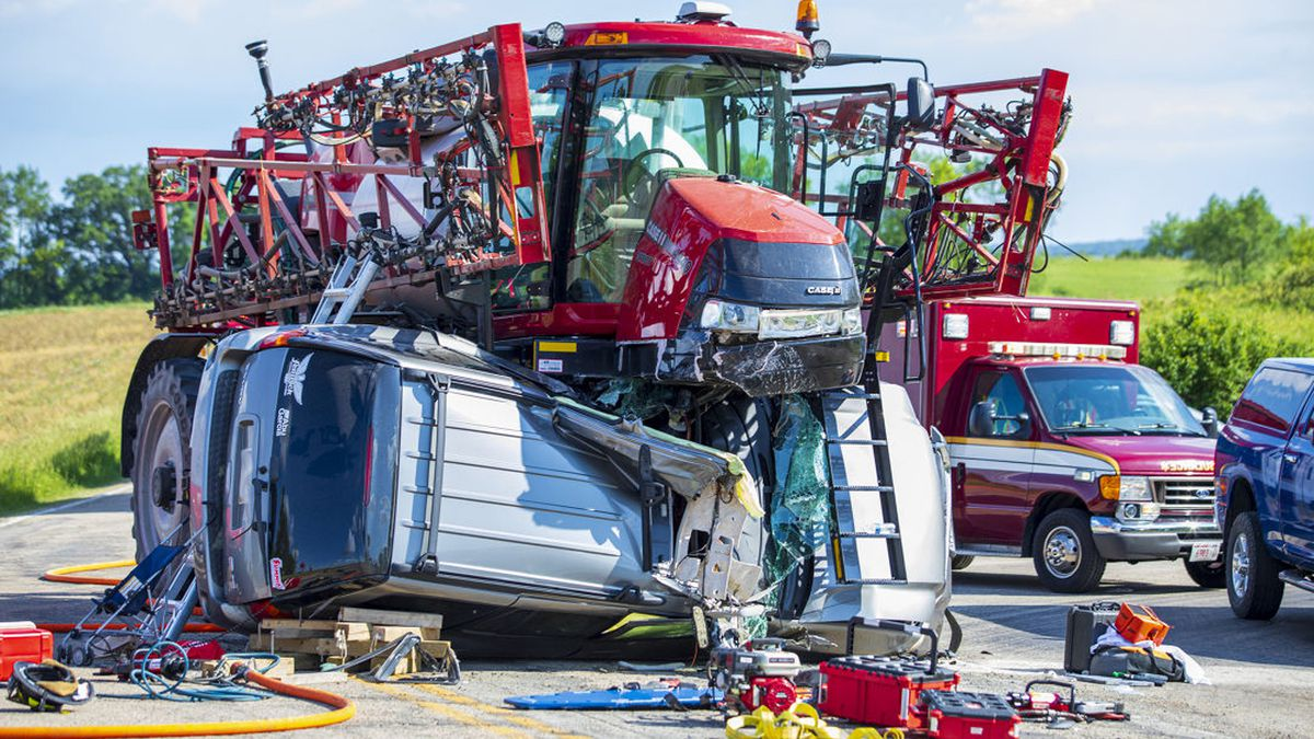 A driver was injured when her SUV collided with farm sprayer.