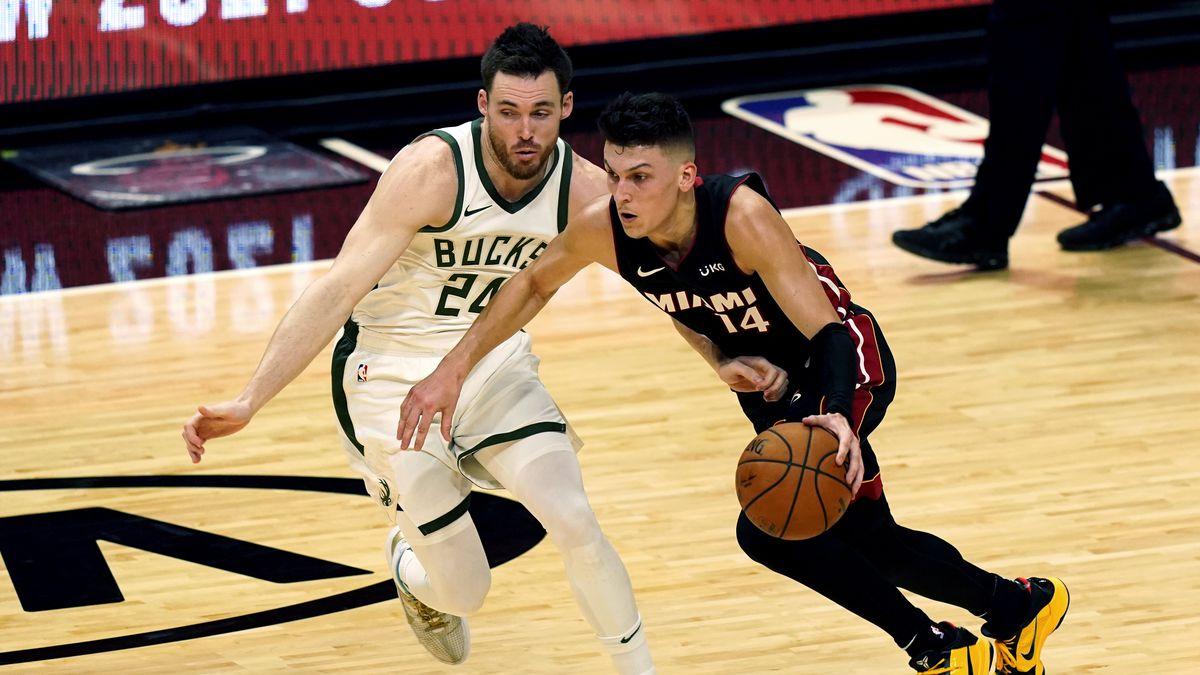 Miami Heat guard Tyler Herro (14) drives to the basket as Milwaukee Bucks guard Pat Connaughton...