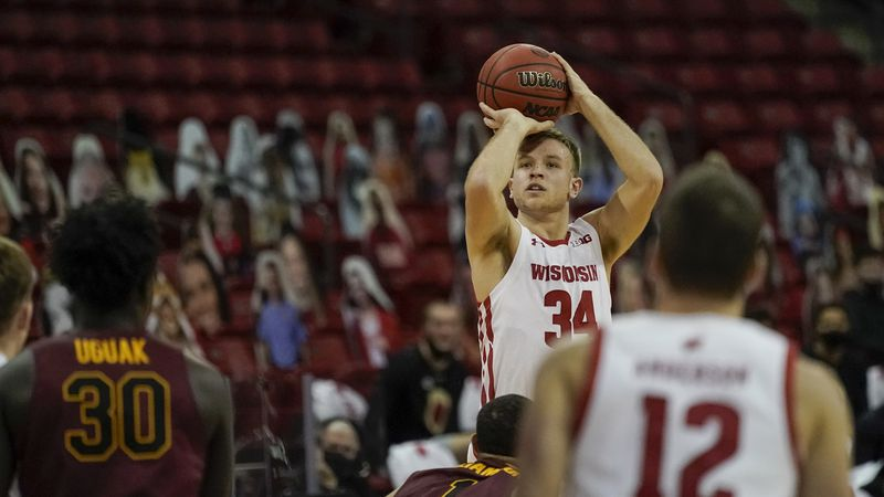 Wisconsin's Brad Davison shoots during the first half of an NCAA college basketball game...