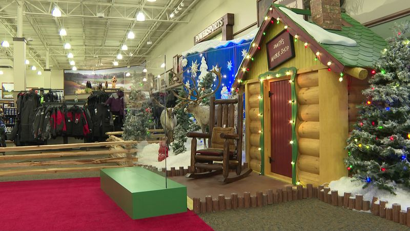 Cabela's in Sun Prairie put Plexiglass between Santa and visitors this holiday season to keep...