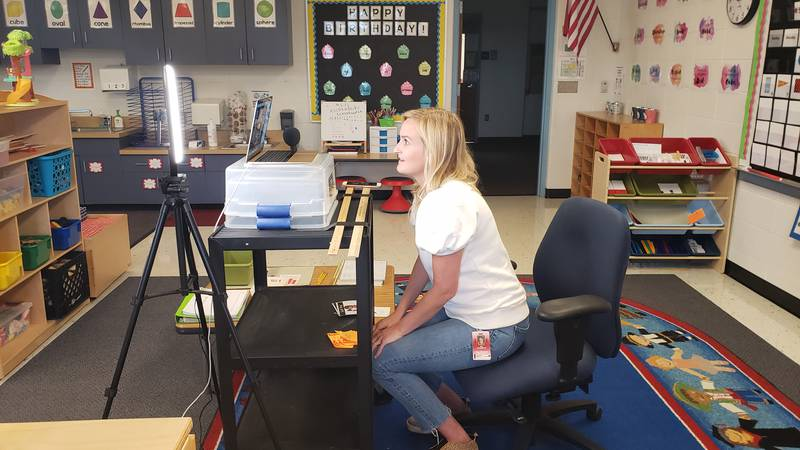 Miss Amy Aschenbeck connects with her kindergarten students for their live morning meeting.
