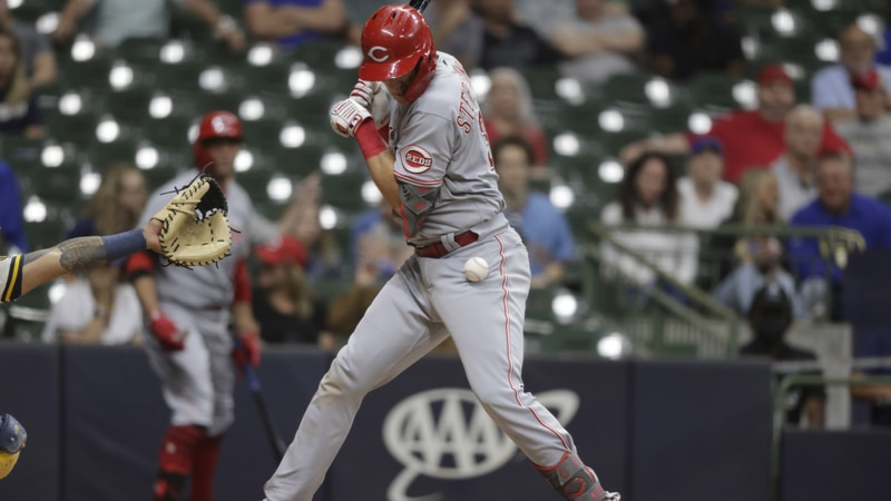 Cincinnati Reds' Tyler Stephenson is hit by a pitch during the 10th inning of the team's...