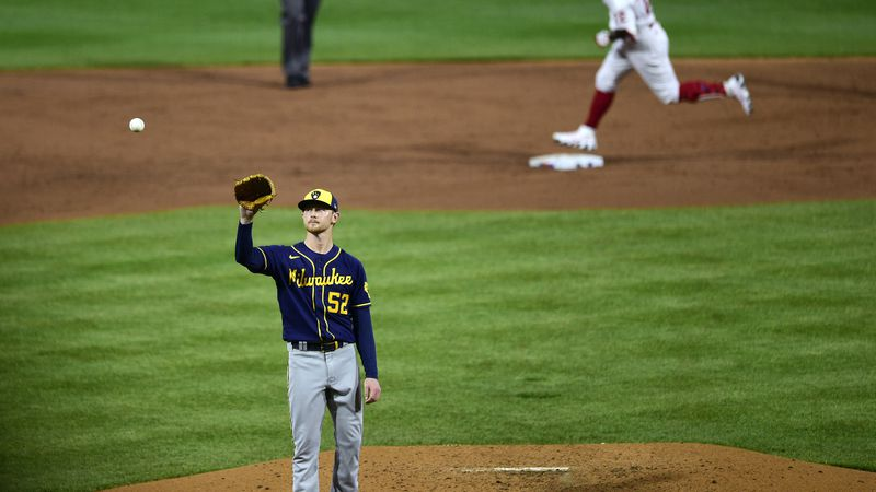 Milwaukee Brewers starting pitcher Eric Lauer receives a new ball after giving up a home run to...