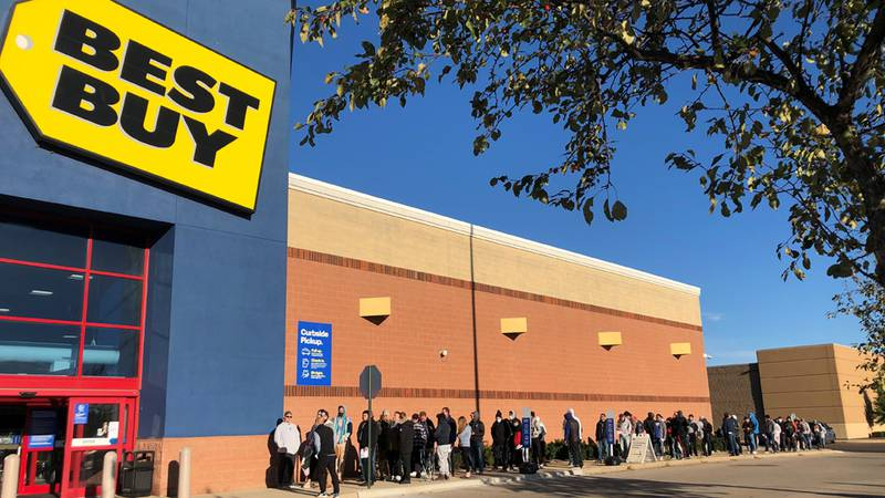 People line up outside the Best Buy in west Madison on Sept. 23, 2021.