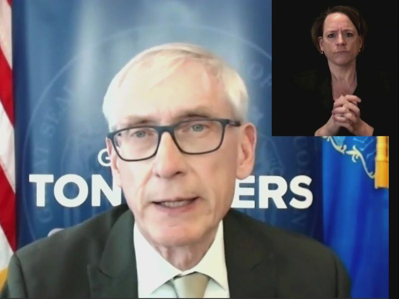 Gov. Tony Evers announces a coming emergency health order will extend the mask mandate in...
