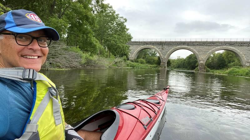 John Stofflet approaches the historic Tiffany Stone Bridge near Clinton on Turtle Creek.