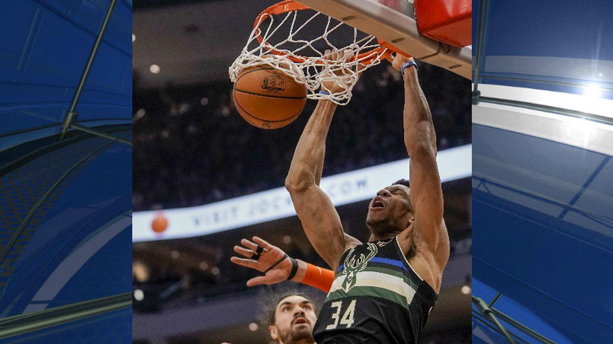 Milwaukee Bucks' Giannis Antetokounmpo dunks over Oklahoma City Thunder's Steven Adams during the second half of an NBA basketball game Friday, Feb. 28, 2020, in Milwaukee. (AP Photo/Morry Gash)
