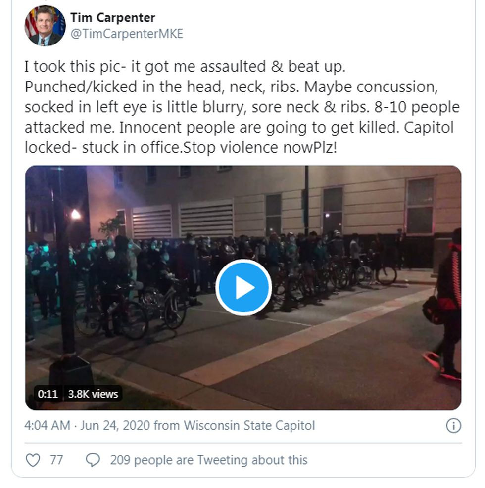 State Sen. Tim Carpenter posted a video showing demonstrators rushing toward him during Tuesday...