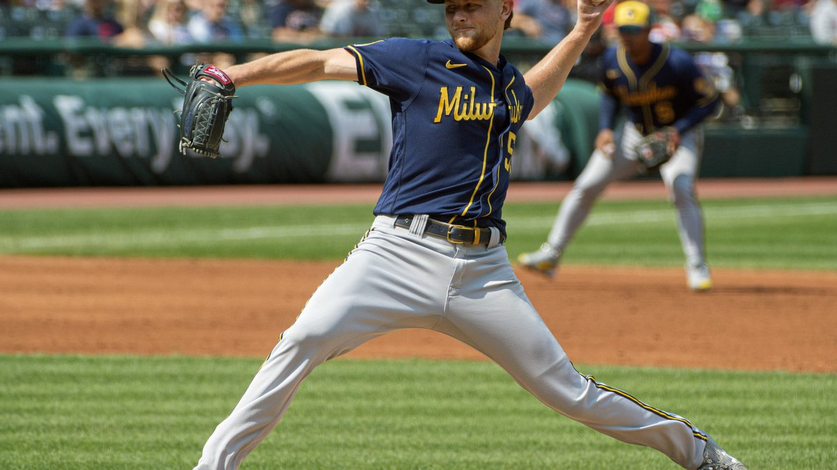 Milwaukee Brewers starting pitcher Eric Lauer delivers against the Cleveland Indians during the...