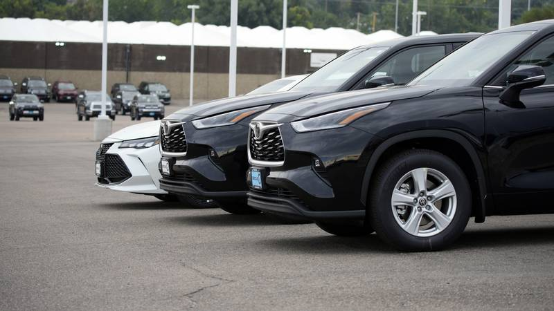 In this Sunday, Aug. 29, 2021, file photo, a pair of unsold 2021 Highlander sports utility...
