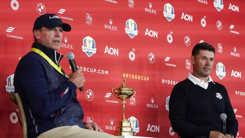 Team USA captain Steve Stricker and Team Europe captain Padraig Harrington answer questions at...