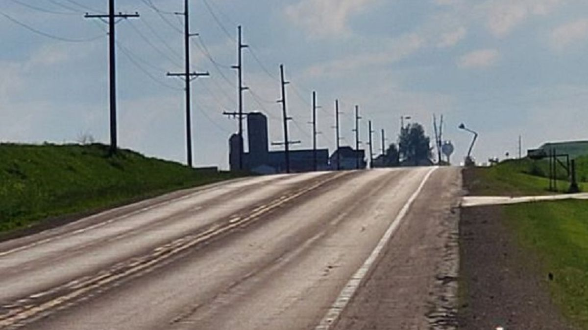 The fallen power lines in the background, near Vienna, Wis. (Source: Lou Thao/WMTV)