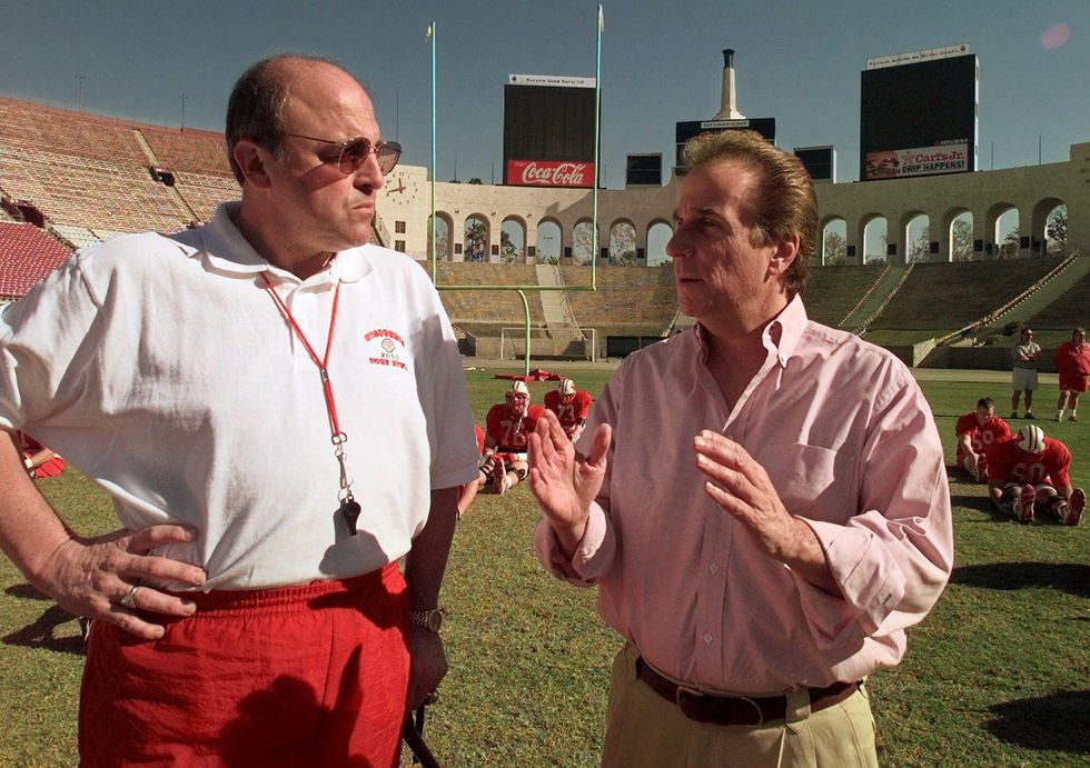 Wisconsin head coach Barry Alvarez, left, chats with actor Henry Winkler during a team practice...