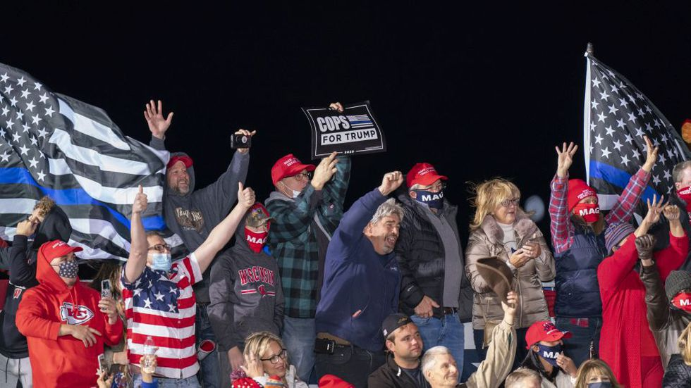 Supporters for President Donald Trump cheer during a campaign rally Saturday, Oct. 17, 2020, in Janesville, Wis. (AP Photo/Andy Manis)