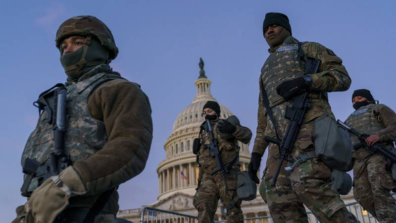 FILE - In this Jan. 19, 2021, file photo National Guard troops reinforce the security zone on...
