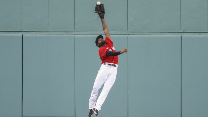 FILE - Boston Red Sox center fielder Jackie Bradley Jr. makes a leaping catch on a ball hit by...