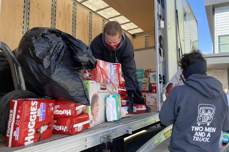 Two Men and A Truck movers load diaper donations