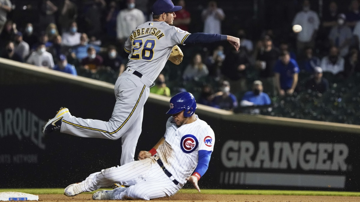 Milwaukee Brewers second baseman Daniel Robertson (28) forces out Chicago Cubs catcher Willson...