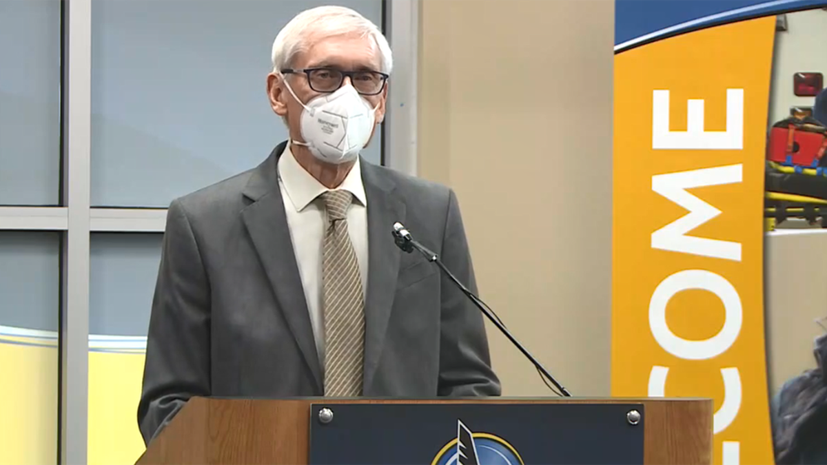 Gov. Tony Evers speaks after touring the state's first community-based COVID-19 vaccine clinic,...