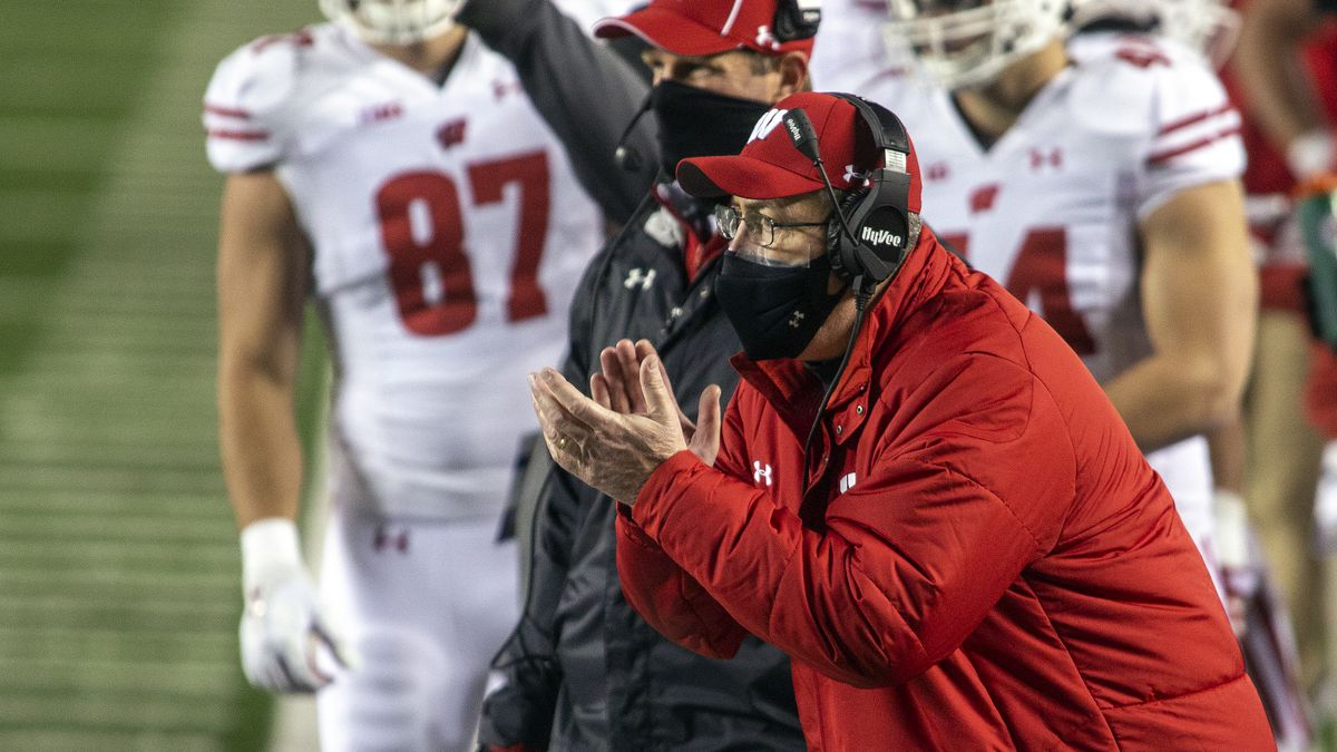 Wisconsin coach Paul Chryst cheers on his players from the sideline during the first quarter of...