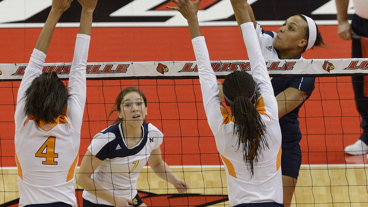 Michigan's Molly Toon, right, attempts to score over the defense of Tennessee's Olivia Okoro,...