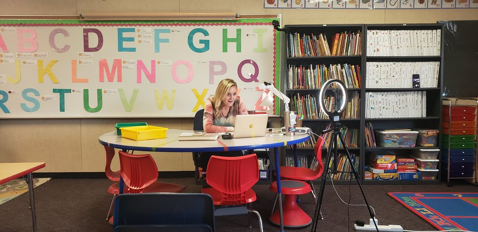 Miss Amy Aschenbeck works with her students in a live, small group to focus on learning...