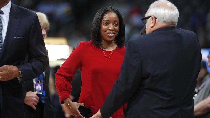 Milwaukee Bucks sideline reporter Zora Stephenson, left, chats with announcer Jim Paschke in...