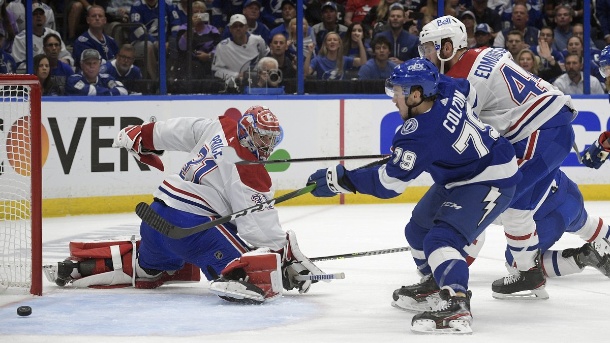 Tampa Bay Lightning left wing Ross Colton (79) scores on Montreal Canadiens goaltender Carey...
