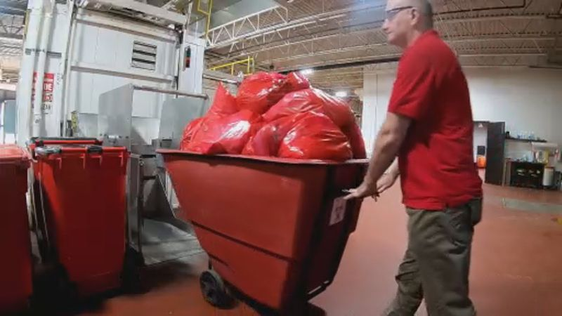 The general manager at MERI prepares another round of medical waste for processing.