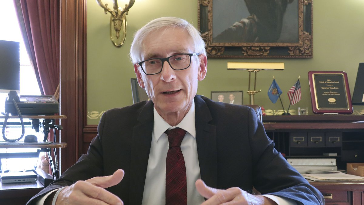FILE - In this Dec. 4, 2019 file photo, Wisconsin Gov. Tony Evers speaks during an interview...