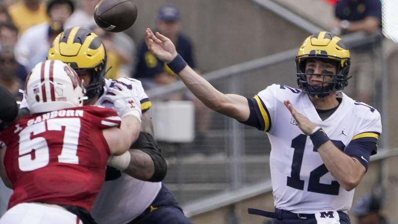 Michigan's Cade McNamara throws during the first half of an NCAA college football game against...