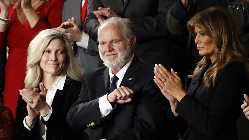 FILE - In this Feb. 4, 2020 file photo, Rush Limbaugh reacts as first Lady Melania Trump, and...