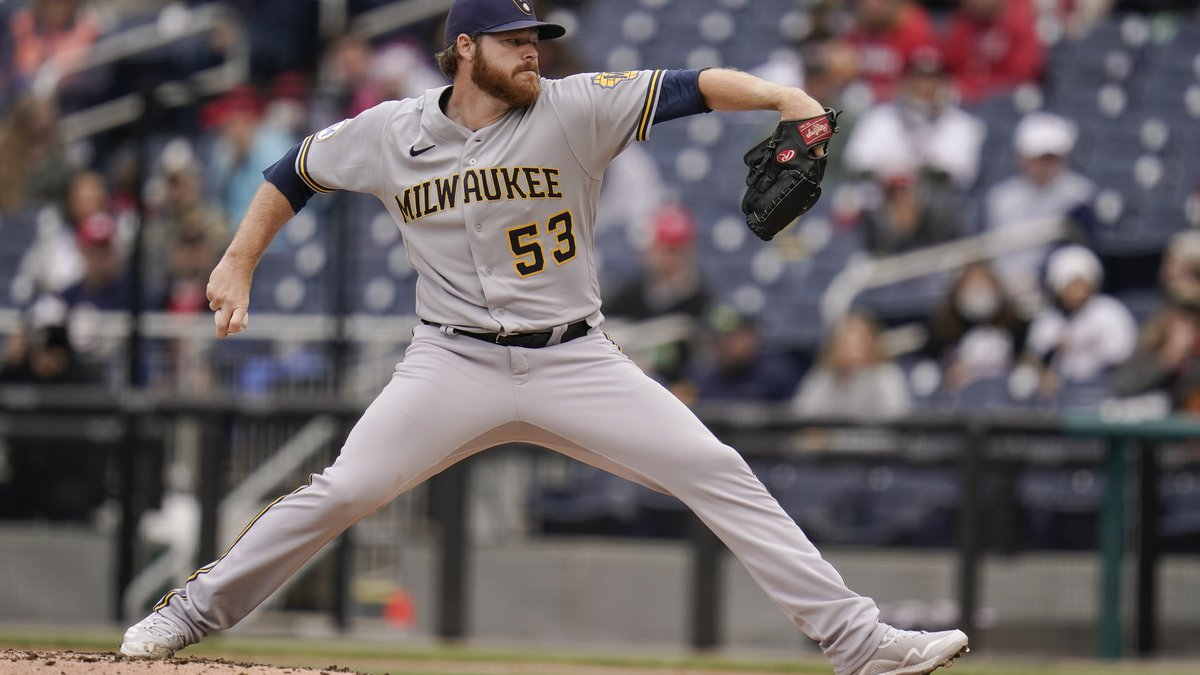 Milwaukee Brewers starting pitcher Brandon Woodruff throws a pitch to the Washington Nationals...