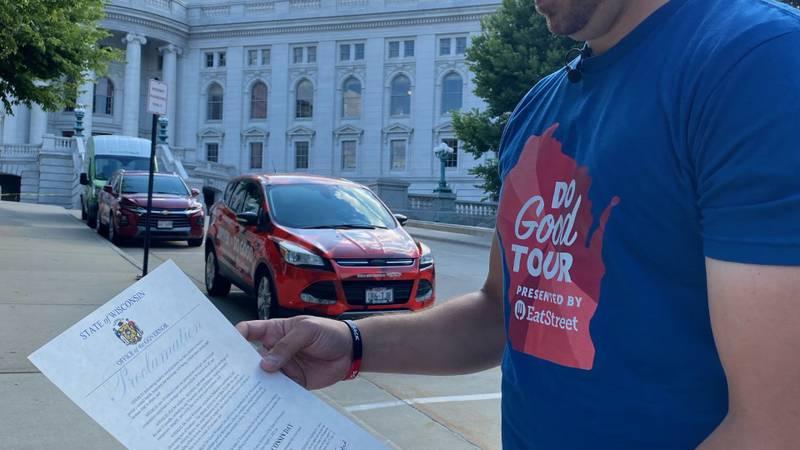 Eric Salzwedel holds Do Good Wisconsin Day proclamation
