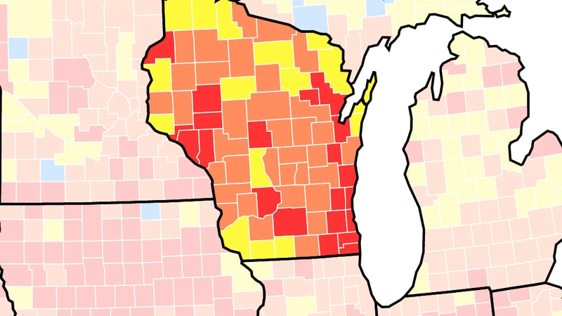 Thursday's Centers for Disease Control and Prevention COVID-19 transmission map shows that Dane...