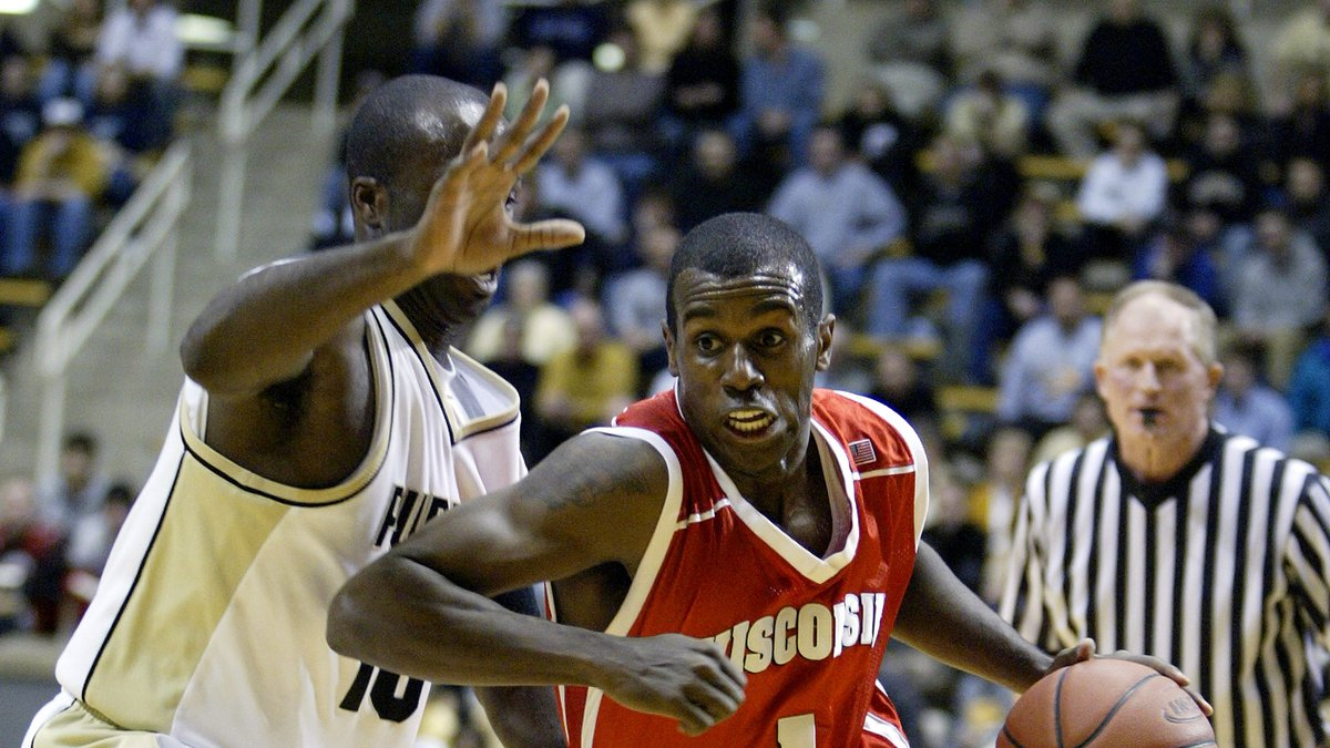 Wisconsin's Sharif Chambliss, right, drives to the bucket past Purdue's Brandon McKnight during...