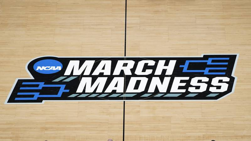 FILE - In this March 20, 2021, file photo the March Madness logo is shown on the court during...