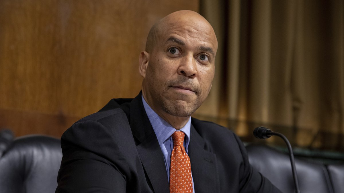 Sen. Cory Booker, D-N.J., listens to other Senate Judiciary Committee members speak during a...