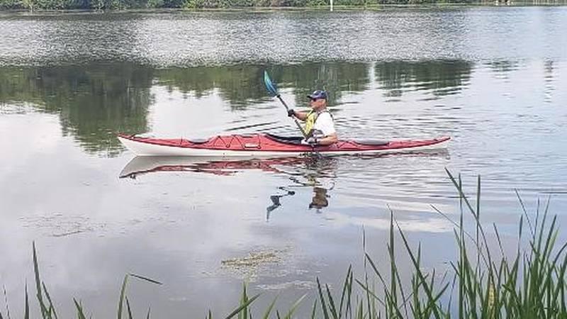 John Stofflet paddles Evansville's Lake Leota.