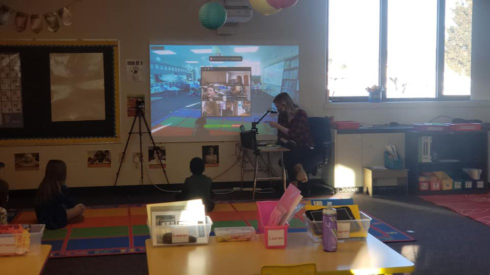 Mrs. Amy Blake teaching a concurrent lesson, working with both the students in her class and...