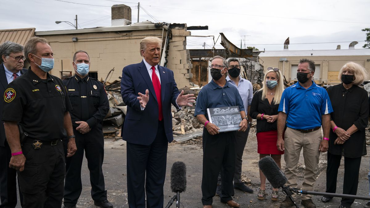 President Donald Trump speaks as he tours an area Tuesday, Sept. 1, 2020, that was damaged during demonstrations after a police officer shot Jacob Blake in Kenosha, Wis.