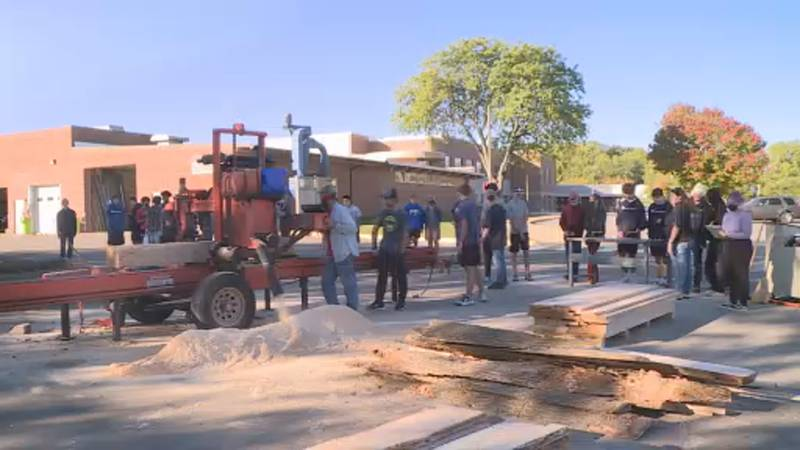 McFarland High School woodshop students learn about the cycle of lumber from a sawmill operator