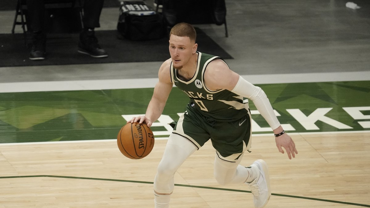 Milwaukee Bucks' Donte DiVincenzo runs during the second half of Game 1 of their NBA basketball...