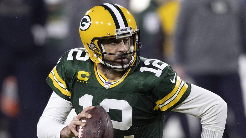 In this Jan. 16, 2021, file photo, Green Bay Packers quarterback Aaron Rodgers (12) runs during...