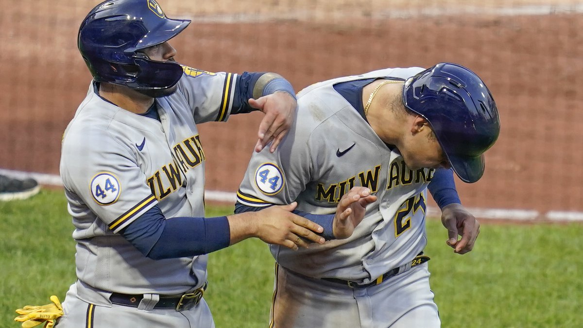 Milwaukee Brewers' Omar Narvaez, left, playfully greets Avisail Garcia, who scored in the...