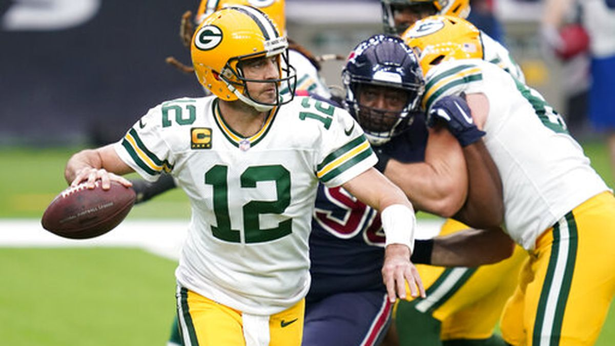 Green Bay Packers quarterback Aaron Rodgers throws during the first half of an NFL football...