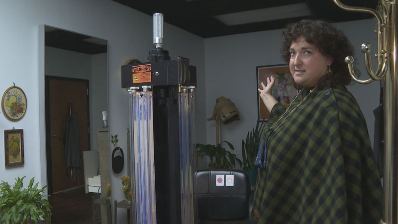 Janesville small business owner, Margie Siggelkow, shows and explains how she keeps her shop...